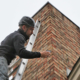 Chimney technicians perform chimney inspections at home on Dresden Dr Brookhaven GA