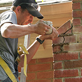 Masonry chimney repairs, tuckpoing services on Rt 120 in Johns Creek GA