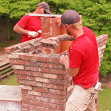 Masonry work being completed on historic chimney - S. Lee St Buford, GA